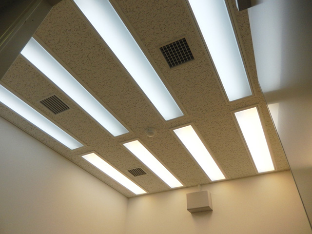 The lighting control system installed in the ceiling.